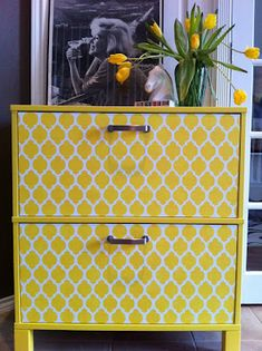 Yellow painted Ikea file cabinet. Make office storage pretty! Could totally make yourself! old file cab + stencil + paint = amazing