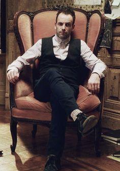 Jonny Lee Miller's Sherlock Holmes in his wing backed chair.