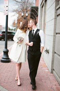 Bride and groom heading to their courthouse wedding