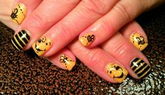 """Light Elegance gel: Pastel yellow with orange crush glitter gel on top and freehand """"Winnie the Pooh"""" nail art"""