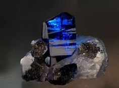 Beautiful Tanzanite - I don't think I've ever seen as rich a blue in a zoisite as this 10 cm specimen on matrix from the Merelani hills of Tanzania. While it has almost certainly been heated to bring out the colour (natural blues only happen when heat has been an immediate part of their geological adventure through deep time), the depth of saturation (pink for example is a light red) and perfection of tone (neither too light or dark) make this a gem to be admired.