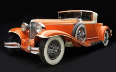 Art Deco autos - 1929 Cord Cabriolet from the collection of Auburn Cord Duesenberg Automobile Museum. This car is part of a new exhibition of shapely, ornamental cars and motorcycles from the and at the Frist Center for the Visual Arts in