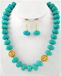 Turquoise Stones. LOVE this piece.