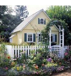 A charming combination of colors and materials dresses up this garden playhouse. Part of the appeal? The fence and arbor, details picked up from the designs found in full-size cottage gardens. Style Cottage, Cottage Living, Cozy Cottage, Cottage Homes, Little Cottages, Cabins And Cottages, Small Cottages, Small Houses, Better Homes And Gardens