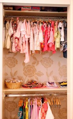 I love the idea of putting wallpaper in the back of a children's closet.