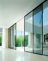 Modern house design with the Rimadesio Valeria glass sliding panels_