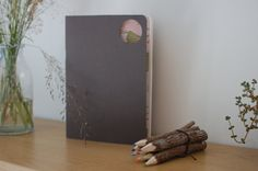 handmade notebook A5 brown with patterned paper insert and circle cutout by behindthesun, $10.00