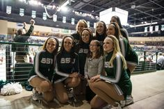 Bemidji State Hockey Cheerleaders with a young fan.