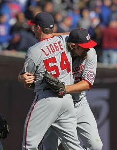 April 5 - NATS at CUBS - Jayson Werth hugging Brad Lidge after securing the win against the Cubs, Final Score: 2-1