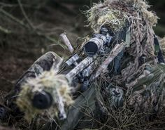 A sniper from 1 Rifles / British Army in position ready to fire. Riflemen from The 1st Battalion The Rifles (1 Rifles) conducting a live fire battle exercise at Otterburn. Photographer Lance Corporal Thomas Evans; Crown copyright.
