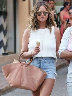 Chrissy Teigen Has Lots of Outfit Ideas for Your Denim Cutoffs via @WhoWhatWear