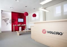 As a part of a global rebranding, Velcro Industries recently worked with designers Luis Eslava and Lorena Sauras to refurbish the European headquarters located in Barcelona. Office Reception Area, Reception Counter, Reception Design, Reception Areas, Movable Walls, Office Entrance, Office Pictures, Separating Rooms, Workplace Design