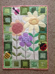 quilted wall hanging, MAY, seasonal, yellow, orange, purple, flowers, lady bug, bumble bee, butterfly, all cotton fabrics, very cute