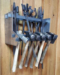 """It has never been easier to get organized. The Compact Tong and Hammer Rack comes standard with two pieces (a left and a right) and has two levels for hanging your tongs and hammers. You can choose to purchase it with four flat bars (16-3/4"""" in length) or fabricate your own to mount it at the length you desire. You can Welding Jobs, Diy Welding, Welding Table, Welding Projects, Blacksmith Projects, Welding Ideas, Metal Projects, Art Projects, Welding Crafts"""