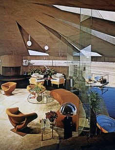 The living room of Arthur Elrod's Palm Springs, California, residence (also featured in the 1971 James Bond film Diamonds Are Forever). The room features ribbon chairs by Turner T and a mobile by Mimi Kornaza. Architecture by John Lautner, interior design by Arthur Elrod. (Spring 1970)
