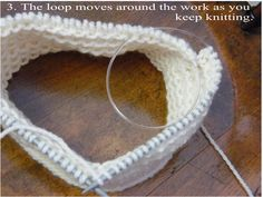 The Travelling Loop.  This method is used for knitting in the round when a circular needle is too long for the work.