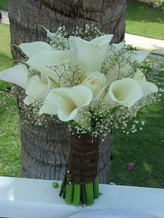 White Calla Lilies, Roses and Baby's Breath Bouquet (except with a black ribbon) this is gorgeous! with babys breath bouquets for the bridesmaids!
