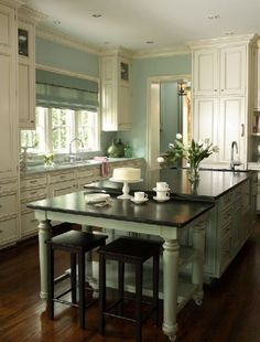 I love, love, love this kitchen!  Vanilla Bean Glaze over Espresso. It's amazing what difference just the color of the walls makes!