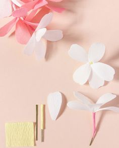 This paper flower garland is designed by contemporary paper artist Susan Beech of A Petal Unfolds. The paper flowers are designed to look like jasmine, a variety which is both easy to replicate and gives the garland a lovely drape.
