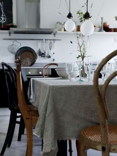 Muslin table cloth with frayed edge. Thonet chairs.  Ecclectic farmhouse,modern style.