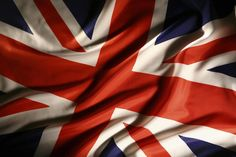 The flag of the United Kingdom of Great Britain and Northern Ireland is sometimes called the Union Jack. This red, white, and blue flag was first used in .