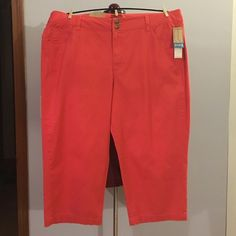 """Merona Coral Cotton Blend Stretch Capris size 18 Up for grabs is this pair of capris from Merona. They are a size 18 with a 22.5"""" inseam and have a 42.5"""" waist and 51"""" hips, both unstretched. These capris are a coral / orange cotton spandex blend that stretch. They sit just below the waist and have a relaxed fit through the hips and thighs. These capris are new with the original tags. Merona Pants Capris"""