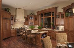 wonderful kitchen--like the window over the sink. Little too much wood--maybe a little white wood mixed in.