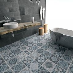 Patterned bathroom floor tiles have been used to completely transform this beautiful modern bathroom.
