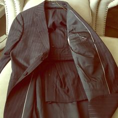 Charcoal pinstripe Armani men's suit. Armani charcoal men's suit. Subtle white pinstripe. Small imperfection on the bottom of one pant leg. Armani Jackets & Coats