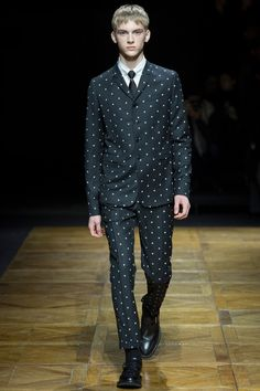 The four-button blazer and the slim, short trouser play well with dots.   Dior Homme Fall 2014