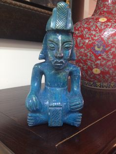 This is a coloured Mexican onyx figure of the Mayan God of Corn - we really like this piece