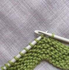 Run out of yarn? Crochet cast-off on a knitted item. Uses no extra yarn! A BIG reason to get comfortable with a crochet hook.