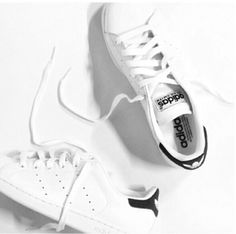 Round toed Adidas white trainers.