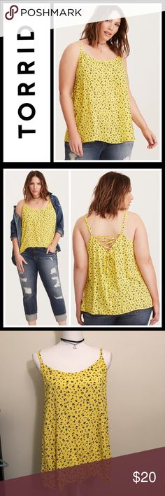 Torrid floral print lace up back cami Perfect used condition, size 0 which is a women's large (see pics for size chart)   Need a little R&R? This semi-sheer sunshine yellow challis cami will have you forgetting your cares, with a lightweight fit and feel that is basically the next best thing to nothing. The navy and white floral print sweetens up the electric style. The lace up back is a grand finale, giving you the chance to adjust. torrid Tops Tank Tops