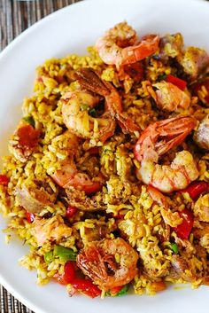 (Spain) Easy paella with chicken, shrimp and sausage. You can use rice (for gluten-free version) or orzo pasta.