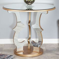 I pinned this Rhonda Side Table from the Regency Studios event at Joss and Main! - Display a fresh autumn bouquet or your favorite framed photos on the elegant Rhonda Side Table, highlighted by a laser cut pedestal silhouette and lustrous mirrored detail for Old Hollywood appeal.