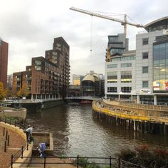 In #Leeds city centre looking towards the new South entrance to Leeds Railway #Station. The scaffolding is now coming down from this #building project. The #water in the picture is the meeting point of the #River #Aire and the Leeds-Liverpool #Canal. #architecture #urban #Yorkshire #England #crane #construction #travel #tourism #tourist