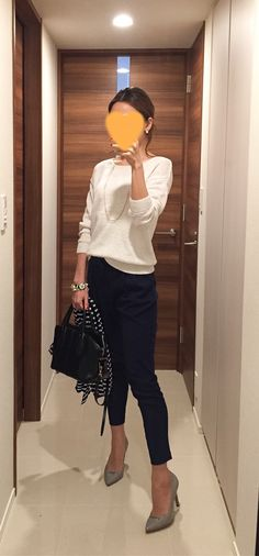 White sweater: Rie Miller, Navy pants: Des Pres, Bag: Tod's, Grey pumps: Pellico