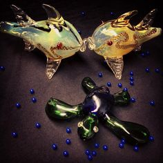 Kissing fish pipes and sea turtle pipe in a sea of blue diffuser beads for your bong.