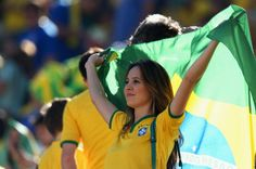 A Brazil fan waves the Brazilian flag before the Opening Ceremony of the 2014 FIFA World Cup Brazil prior to the Group A match between Brazil and Croatia at Arena de #SaoPaulo on June 12, 2014 in #SaoPaulo, #Brazil.