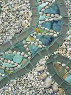 David Chidgey:  mosaic path ... river rocks and colored blocks ...
