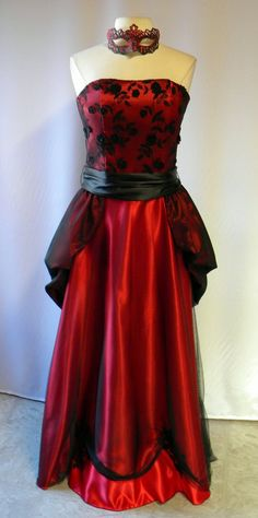 Strapless with black lace and red satin,  beaded and appliqued Masquerade party gown has a mask for theme events. #GothicPromDress #RedAndBlack #DarkLongGown #ChristmasGala #SatinAndMesh