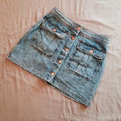 """buttoned denim skirt Worn only once. Great Condition. Very minimal sign of normal wear/wash. Size M, fits slightly small. (Can fit size 25 or 26, equivalent to size 2 or 4).   Measurements: Length- approx. 14"""", Waist- approx. 14"""" across.  Not Modeling. No Hold. No Trade. Price is Firm. Zara Skirts"""