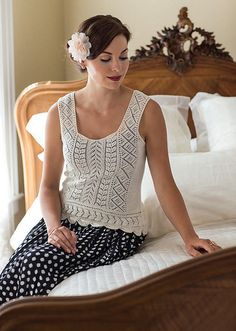 Front and back central panels are knitted first, from the top toward the waist; knitting changes direction as stitches are picked up from the sides of the central panels with extra stitches cast on between panels for neck and shoulder strap, knitting outward toward the underarm shaping. The neck at the top of central panels and the eyelet border on the shoulder straps are cast on and bound off with yarn held double; this reinforces the no-finish selvedges at straps and neck, and the…
