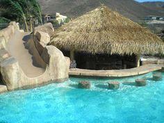 Swim up bar by Arizona Falls Las Vegas Pool Bar, Backyard Paradise, Backyard Retreat, Arizona Falls, Swim Up Bar, Rectangular Pool, Backyard Pool Designs, Backyard Ideas, Garden Nursery
