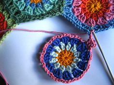 pattern for making and assembling a hexagon throw. such pretty colors! and a nice alternative to the traditional granny square