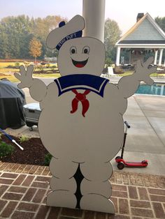 Cut this guy out with a skilsaw and plywood. Painted body with room paint and details with acrylic paints. Fun and easy addition to my nephews Ghostbusters birthday party!