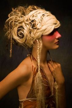 Avant garde updo with dreads and braids