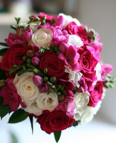 vanillarose.co.uk Hand tied bridal bouquet with cerise freesias and roses