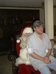 Jeffrey in a rare photo with his brother Steven playing Santa.  Always makes me laugh.